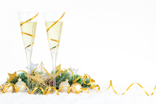 New Year Celebration with Champagne Glasses. New Year golden ribbon flutes with bubbling champagne.