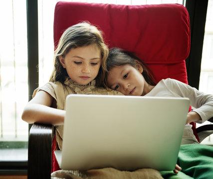 Girls Friends Laptop Using Concept