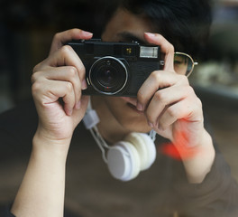 Young guy taking photos from a cafe