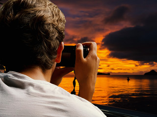 Backside of man taking photo of the sea, dicut concept.