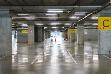 interior of parking garage with vacant parking lot in parking building,