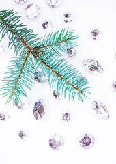 Blue spruce branch with crystals for decoration.