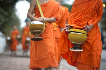 Buddhist monks on everyday morning traditional alms giving in Luang Prabang, Laos.
