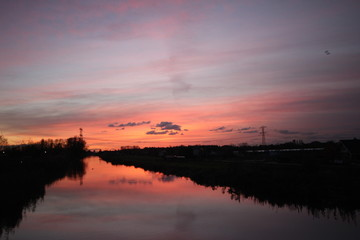 Sunset over the ring canal in Nieuwerkerk aan den IJssel with nice colors and reflection in water