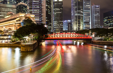 Singapore river with rushing boats at night in Singapore.