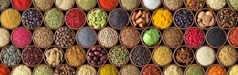 Foto op Canvas Kruiden Different seasonings in cups. Spice background on the table