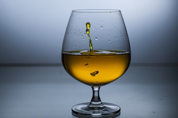Big wine glasses with liquid splashes