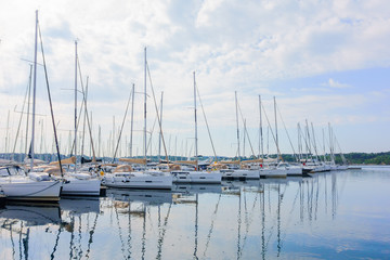 Yachts and boats parked in harbor, sunrise, morning