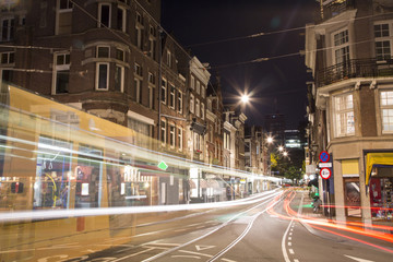 Tram moving fast at night in Amsterdam