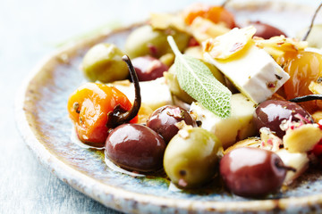 Marinated olives, habanero peppers and feta cheese on a plate