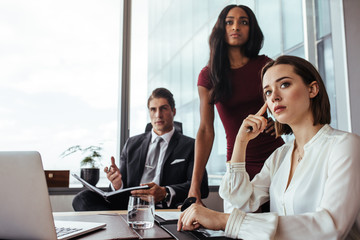 Woman with colleagues during a meeting in office