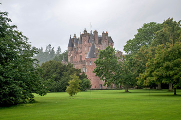 A really large Glamis castle with a garden located in central Scotland