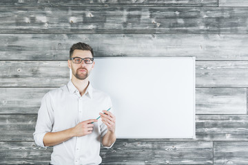 Young man pointing at whiteboard