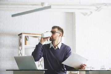 Man with coffee at workplace