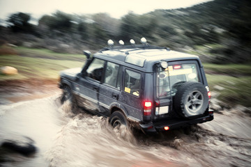 Driving Off Road Car  in the mud