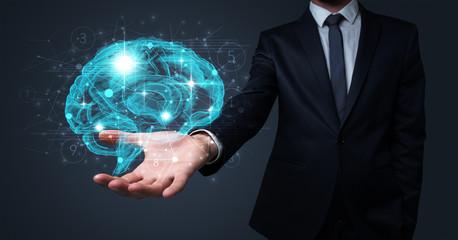 Man holding human brain on his hand