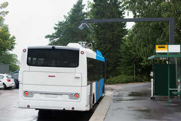 Electric bus is charged by wireless induction charging