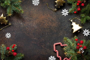 Christmas composition. Christmas tree and decorative ornaments on a dark stone and slate background. Flat lay, top view with copy space.