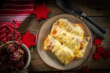Italian lasagna rolls on a plate. Small depth of field.