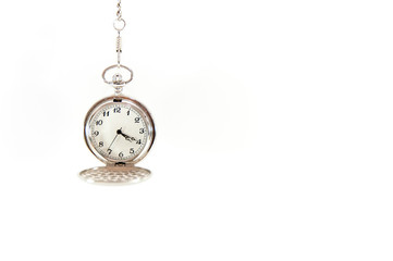 Old, hanging pocket watch isolated on white background.