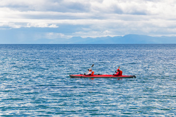 A couple travels by canoe on the big lake