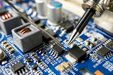 Repair microchip with soldering iron and tin