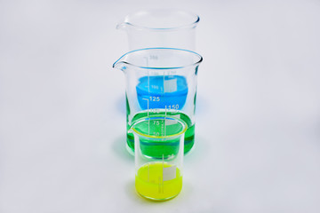 Glass beaker set stock images. Glass Measuring Beaker. Laboratory beaker on a white background. Beaker with colored liquid