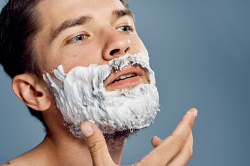 man in foam and ready to shave