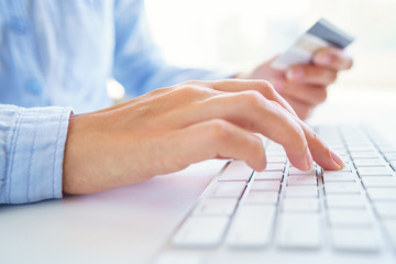 Woman using a credit card for online payments. The concept of online shopping