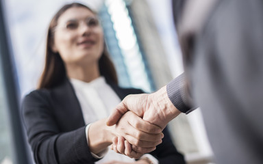 Businesspeople making hand shake in the city