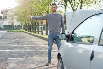 Man and car engine breakdown problem