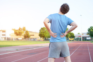Sportsman feeling backache because of slipped disc