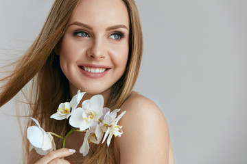 Beautiful Smiling Woman With Flowers Portrait