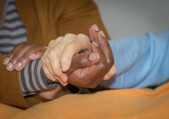 Hand of nurse holding a senior woman. Concept of helping hands, care for the elderly