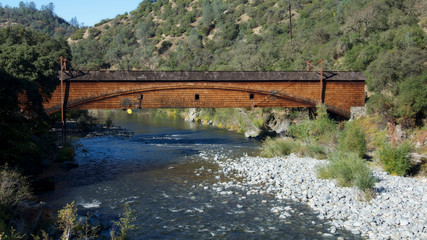 Side view of the bridgeport Covered Bridge at South Yuba River in California, USA. This bridge has the longest clear span of any surviving covered bridge in the world