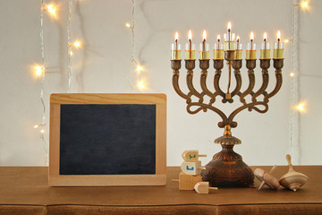 image of jewish holiday Hanukkah background with traditional spinnig top, menorah (traditional candelabra)