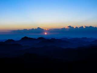 Sunrise in the holy summit of Mount Sinai, Aka Jebel Musa, 2285 meters, in Sinai Peninsula in Egypt. Copy space.