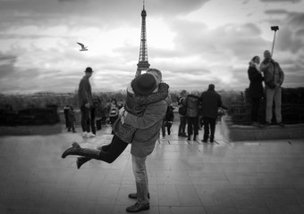 couple in love kissing and embraced in front of eiffel tower.