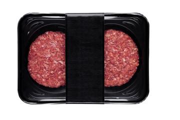 Raw fresh beef burgers in plastic tray