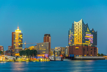 Night view of the port of hamburg with the elbphilharmonie building, Germany.