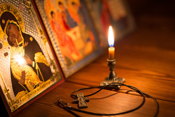 burning candle in a dark room, orthodox