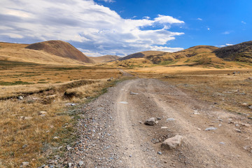 Amazing summer landscape with mountain road and blue sky with cl