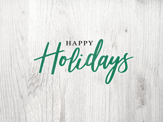 Wall Mural - Festive Happy Holidays Calligraphy Text Over White Rustic Wood Background