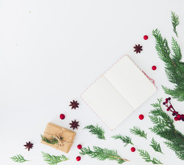 Creative composition of notebook with fir tree on white table top view. Planning concept. Christmas background. Flat lay. Copy space