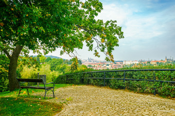 Parapet and bench in the park of the fortress of Vysehrad in Prague in the Czech Republic in the fall. View of the Prague Castle