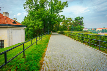 The path and parapet on the fence of the Vysehrad fortress in Prague in the Czech Republic in the fall.