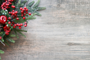 Christmas Evergreen Branches and Berries in Corner Over Rustic Wooden Background
