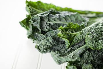 Macro shot of freshly washed bunch of green kale white background
