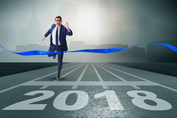 Businessman running towards new year  2018