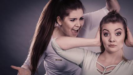 Two women having argue